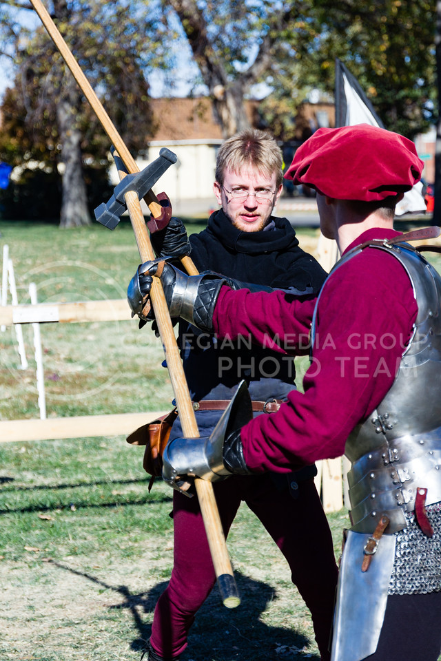Robert Trigueros, and Josh Warren practice sparring for a show put on by Broken-Arm Academy of Swordsmanship at Little Apple Renaissance Fair on the 29th October 2017 (Alex Shaw | Collegian Media Group)