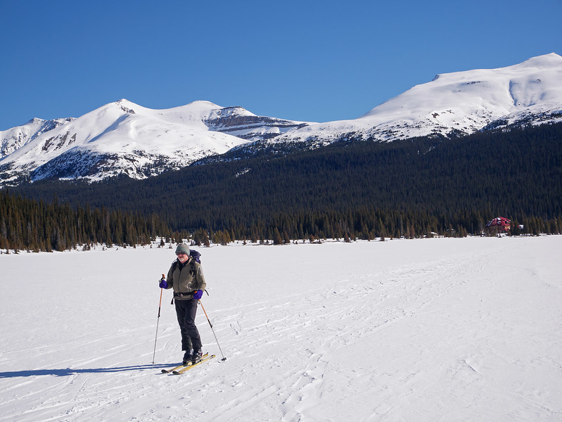 Andrew, setting out on a bluebird morning across Bow Lake from Num-Ti-Jah lodge.