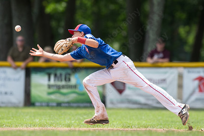 Wallingford's Justin Hackett reaches for a ball he deflected from Farmington's Shane Hurley Saturday during the Little League District 5 Championship at Recreation Park in Southington  Jul. 15, 2017 | Justin Weekes / For the Record-Journal