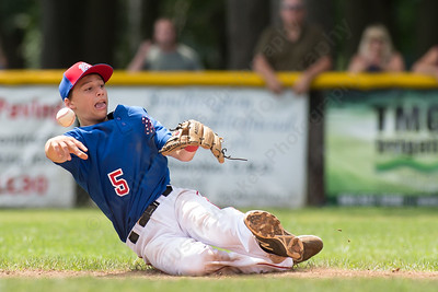 Wallingford's Justin Hackett tries to throw to second after fielding a hit from  Farmington's Shane Hurley Saturday during the Little League District 5 Championship at Recreation Park in Southington  Jul. 15, 2017 | Justin Weekes / For the Record-Journal