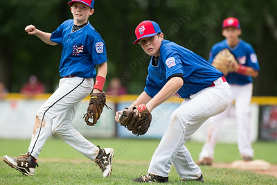 Wallingford's John Cady turns to first after fielding a hit Saturday during the Little League District 5 Championship at Recreation Park in Southington  Jul. 15, 2017 | Justin Weekes / For the Record-Journal