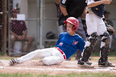Wallingford's John Carrozella slides into home plate for a run Saturday during the Little League District 5 Championship at Recreation Park in Southington  Jul. 15, 2017 | Justin Weekes / For the Record-Journal