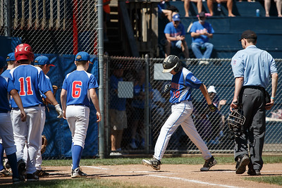Wallingford's Kevin Milewski lands on home plate after ringing the flag pole in center field Saturday during the sectional finals at Peter J Foley Stadium in Naugatuck July 21, 2018 | Justin Weekes / Special to the Record-Journal