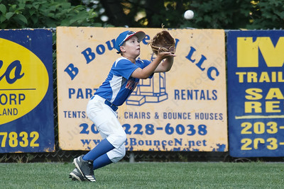 Wallingford's Connor Nickischer brings in a fly ball Wednesday at Peter J. Foley Little League Park in Naugatuck July 18, 2018 | Justin Weekes / Special to the Record-Journal