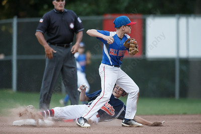 Wallingford's Kyle Mitchell turns to first after getting the force out at second Wednesday at Peter J. Foley Little League Park in Naugatuck July 18, 2018 | Justin Weekes / Special to the Record-Journal
