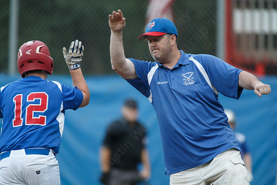 Wallingford's head coach Brian Mitchell gets a high five from Simeon Levesque after hitting a home run Wednesday at Peter J. Foley Little League Park in Naugatuck July 18, 2018 | Justin Weekes / Special to the Record-Journal