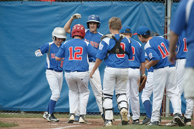 Wallingford celebrates at home plate with Simeon Levesque after a home run Wednesday at Peter J. Foley Little League Park in Naugatuck July 18, 2018 | Justin Weekes / Special to the Record-Journal
