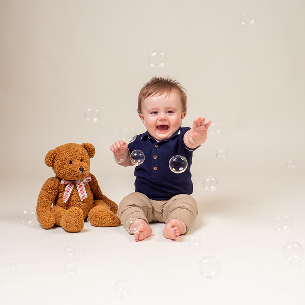 Baby Smiling and Playing with Bubbles for little sitters baby photos