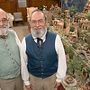 Darrel Hopkins, on left, and Thomas Casey Hopkins of Westminster stand near their Little Town of Bethlehem that they have brought to the Fitchburug Senior Center for the second year. SENTINEL & ENTERPRISE/JOHN LOVE
