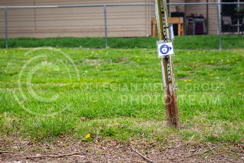 BikeWalkMHK and the city of Manhattan came together to create the Little Apple Loop. This is one of the trail markers on the 22.5-mile loop. 4/27/21. (Jared Newell | Collegian Media Group)