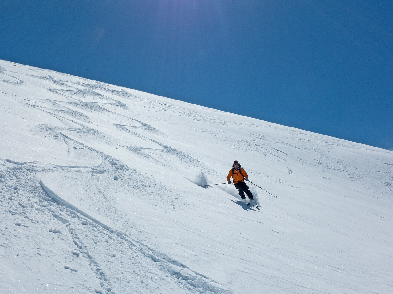 It was good enough to skin back up the glacier for another go. Bob enjoying the fast skiing in wind sifted powder.