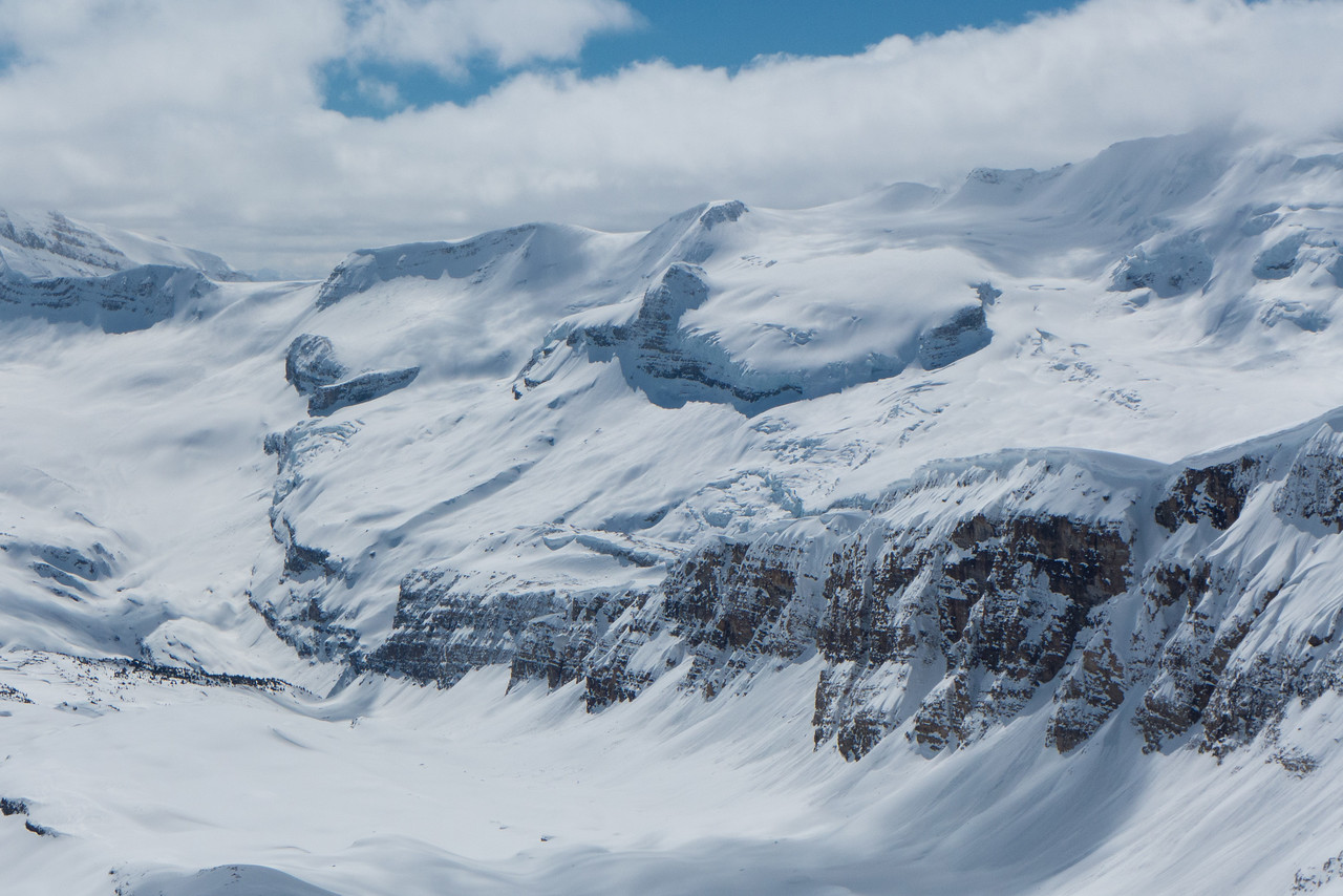 Balfour Glacier, and the Wapta traverse route over the high col, below  the summit of Mount Balfour hiding in the clouds.