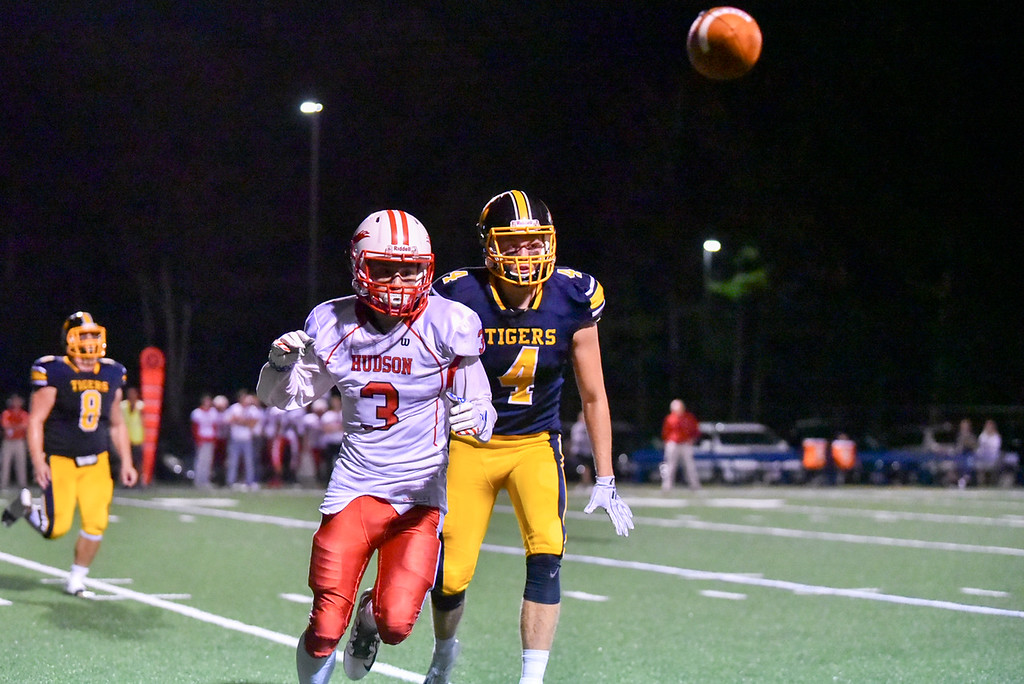 . Hudson junior Tyler Chaves (left) watches misses the overthrown pass with pressure from Littleton senior Austin Lynn during Friday night\'s football match up at Littleton Middle School.  Sun/Jeff Porter