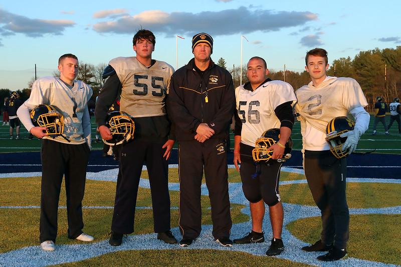 Littleton High School football captains pose with Head Coach Mike Lynn, center. From left is seniors Kevin Frisoli, Brandy Hunt, Lynn, Jake Kivlin and Brad Klock. SUN/JOHN LOVE
