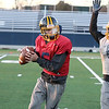 Littleton High School football held a practice on Wednesday to get ready for Saturday's Super bowl game at Gillette Stadium. Kerr Boyle tries to block freshman quarterback Braden Lynn during the practice. SUN/JOHN LOVE