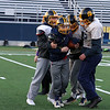 Littleton High School football held a practice on Wednesday to get ready for Saturday's Super bowl game at Gillette Stadium. Freshman running back Parker Landfos is rapped up during the practice. SUN/JOHN LOVE