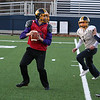 Littleton High School football held a practice on Wednesday to get ready for Saturday's Super bowl game at Gillette Stadium. Sophomore quarterback Tony DeSisto looks for an open man before he is tackled during the practice. SUN/JOHN LOVE