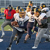Littleton High School football held a practice on Wednesday to get ready for Saturday's Super bowl game at Gillette Stadium. Junior Cam Mossey runs with the ball during the practice. SUN/JOHN LOVE