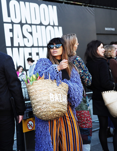 Fashion blogger Kavita Donkersley was captured attending London Fashion Week today with furniture and décor brand Maisons du Monde's Bazar Woven Wicker Basket bag on her arm. The news comes as Maisons du Monde announce the hottest trend to come out of London Fashion Week 2018 – using storage baskets as a fashion accessory' <br /> <br /> FREE FOR EDITORIAL REPRODUCTION