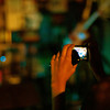 Amulya Datla films during a song by Cartoon Bar Fight.<br /> <br /> Photo by Jessica Shirley-Donnelly, JRSD Photography