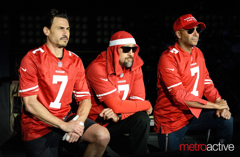 Prophets of Rage (Brad, B Real, Tom) knell during the National Anthem wearing Colin Kaepernick Jersey's