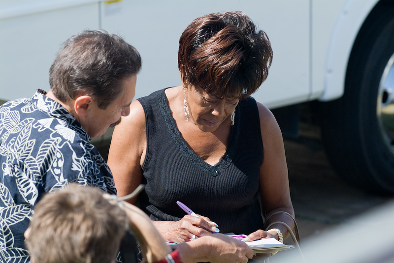 Betty Harris signing an autograph backstage