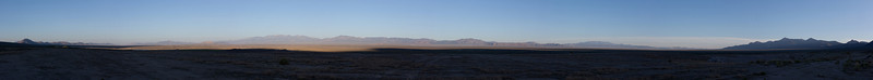 Panoramic of the morning sun creeping towards us across the desert (Click on the thumbnail for the expanded view, then choose a larger format for the full effect)