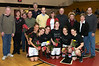 Six Sexier Seniors surrounded by their parents smile for the camera on Senior Night for QO Winter Sports