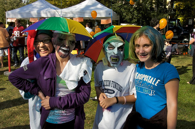 OctoberFest. Sammie Kahn, Allison Baugman, Abbie Berissord, and Jenni Meow parade through the Kentlands Green during OctoberFest.