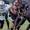 USE THIS VERSION  of #2 Bani Gbadyu breaking through the offensive line heading for a TD in 2005 for QO.