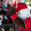 Screech, Nationals Mascot visits with Miracle League Players and their parents before the ribbon cutting.