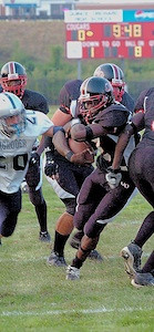 #2 Bani Gbadyu breaking through the offensive line heading for a TD in 2005 for QO.