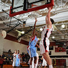 QO JOey Portney drives for an easy second half score against Einstein