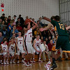 An excited QO bench watches as Ben Kelly launches a 3 point attempt against Seneca Valley
