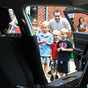 Jr Detectives and their parents peer into a City of Gaithersburg police car.