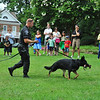 City of Gaithersburg Ofc Bennet shows Jr Detectives and thier parents how a police dog is trained.