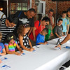 Jr Detectives sign up with the City of Gaithersburg and will be instructed on how to process fingerprints.