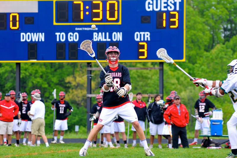 QO Senior Carson Stewart controls the ball at mid field against Seneca Valley