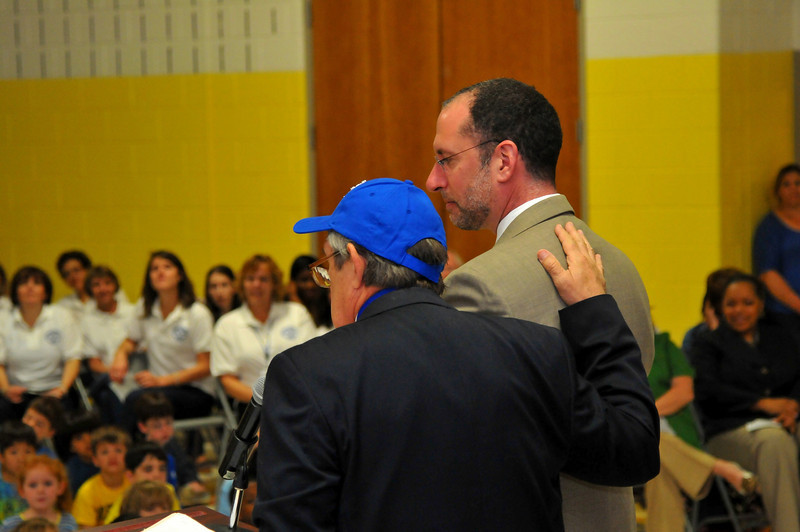 Acting Maryland State Superintendant of Public Schools pats Dr. Starr on the back at RCES Blue Ribbon Award assembly