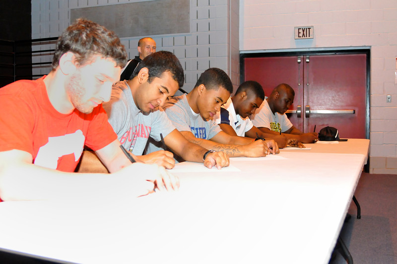 QO Seniors Eli Bienstock (Wrestling - Cornell); Myck Miller (Basketball - BYU-Hawaii); Mark Green Football - Shepard); Darnell Leslie (Football - Monmouth) and Brandon McDowell (Football/Track - Bowie St) all sign at National Letter of Intent day.
