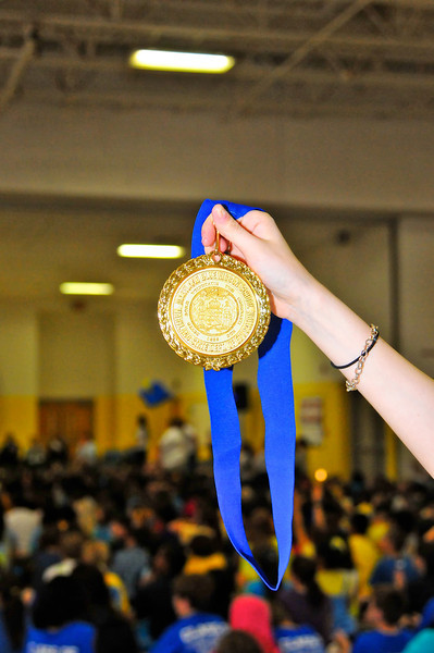 Maryland State Blue Ribbon Award held high above the students and staff at RCES