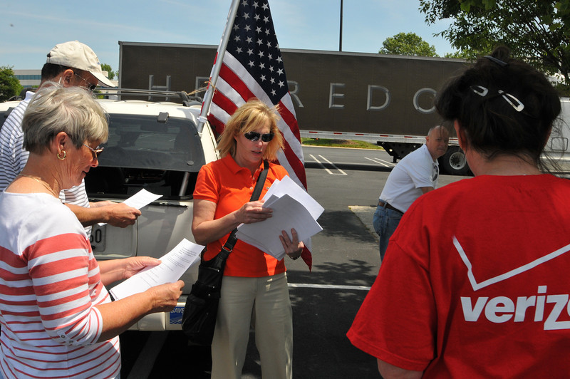 Tea Party Rally held at Lowes Kenlands. Arelene Hillerson hands out circulars at the rally.
