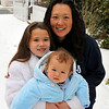 Baby's first snow.  Bear McFadden held by sister Emily and accompanied by Mom Sooky is out in his first snow