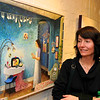 Artist Cassie Taggart with one of her paintings on display at the Art Barn