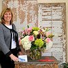 Kim Kelly, owner of Kentlands Flowers & Bows prepares for Valentine's Day