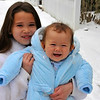 Baby's first snow.  Bear McFadden held by sister Emily is out in his first snow