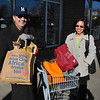 Harley Mazuk and Tasia Agne with bags in front of Whole Foods