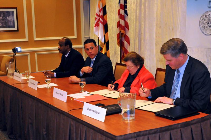 L to R Montgomery County Executive Ike Leggett, US Senator Barbara Mikulski (MD) and NIST Director Patrick Gallagher sign MOU on NCCOE