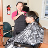 Judy Fang with customer JJ Jen at the Family Barber Shop