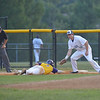 Gaithersburg Giants versus Vienna Dogs at Kelly Park<br /> <br /> Vienna's Ray Lopez makes it back to first base beating the pick off move by pitcher Trevor Houck